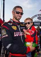 Sep 7, 2015; Clermont, IN, USA; NHRA top fuel driver Morgan Lucas holds son Hunter Lucas during the US Nationals at Lucas Oil Raceway. Mandatory Credit: Mark J. Rebilas-USA TODAY Sports