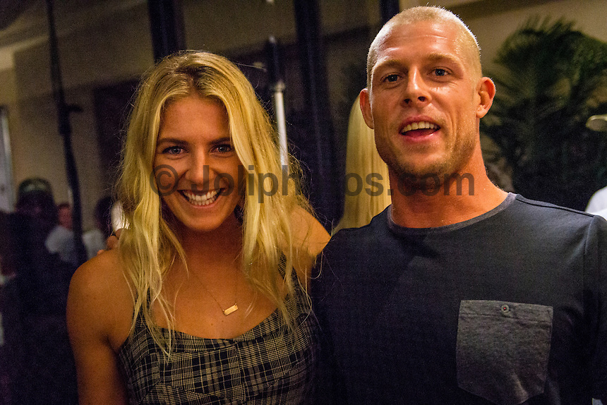 North Shore, Oahu, Hawaii (Friday, December 6, 2013) Stephanie Gilmore (AUS)  and Mick Fanning (AUS). &ndash; The 44th Annual Surfer Poll Awards  were held tonight at the Turtle Bay Resort on the North Shore of O&rsquo;ahu. The ceremony brought together the best surfers, filmmakers, and surf legends all under one roof to honor the best films and performances of the year.<br /> <br /> Each year the SURFER staff pores through all of the full-length films and web shorts produced that year, narrowing down hundreds of great rides and notable moments to just a handful of nominees. And while it&rsquo;s always a challenge, this year there was one surfer/co-director who dominated the movie categories: John John Florence (HAW). Not only was he voted second in the reader poll, he also took home Best Performance for his surfing in Done, Best Short for his film Begin Again and Movie of the Year for Done, both of which he co-directed with Blake Kueny (USA).<br /> <br /> For the Men&rsquo;s reader poll, it came as no surprise that once again Kelly Slater (USA) who took the No. 1 slot, making this his 19th Surfer Poll win since he first topped the list in 1993. On the women&rsquo;s side of the poll, it was Alana Blanchard (HAW) who was voted into the top slot over current World Champion Carissa Moore  (HAW) (Women&rsquo;s No. 3) and five-time World Champion Steph Gilmore (AUS) (Women&rsquo;s No 5). This is her first time winning the Women&rsquo;s No. 1 award, up from No. 2 in 2012.  Photo: joliphotos.com