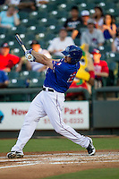 Round Rock Express outfielder Brad Snyder (25) swings the bat during the Pacific Coast League baseball game against the Omaha Storm Chasers on June 1, 2014 at the Dell Diamond in Round Rock, Texas. The Express defeated the Storm Chasers 11-4. (Andrew Woolley/Four Seam Images)