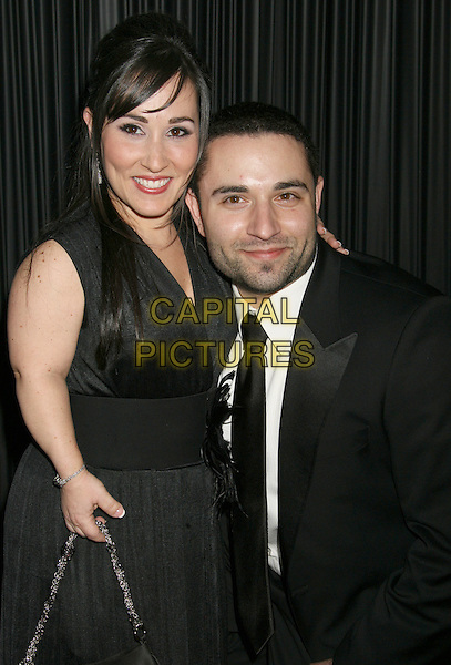 MEREDITH EATON & BRIAN GORDON .NBC, Universal Pictures and Focus Features 66th Annual Golden Globe After Party sponsored by Cartier held at The Beverly Hilton Hotel, Beverly Hills, California, USA, 11 January 2009..globes half length midget black dress dwarf husband wife tie suit .CAP/ADM/MJ.©Michael Jade/Admedia/Capital Pictures