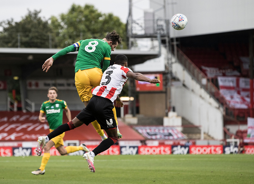 Preston North End's Alan Browne heads under pressure from Brentford's Rico Henry <br /> <br /> Photographer Andrew Kearns/CameraSport<br /> <br /> The EFL Sky Bet Championship - Brentford v Preston North End - Wednesday 15th July 2020 - Griffin Park - Brentford <br /> <br /> World Copyright © 2020 CameraSport. All rights reserved. 43 Linden Ave. Countesthorpe. Leicester. England. LE8 5PG - Tel: +44 (0) 116 277 4147 - admin@camerasport.com - www.camerasport.com