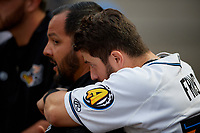 Akron RubberDucks Tyler Friis (38) hugs trainer Bobby Ruiz during an Eastern League game against the Reading Fightin Phils on June 4, 2019 at Canal Park in Akron, Ohio.  Akron defeated Reading 8-5.  (Mike Janes/Four Seam Images)