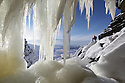 "22/01/13<br /> <br /> Photographed from behind the waterfall Andrew Cherry marvels at the frozen phenomena before starting his climb.<br /> <br /> After many days below zero a giant waterfall has now frozen solid attracting climbers to tackle the huge 30 metre ascent up the freshly formed icicles and towers of ice. Known as Kinder Downfall the waterfall is the tallest in the Peak District. The river Kinder cascades over the top of the Kinder Scout plateau near the Pennine Way 2,087 ft above sea level mid-way between the villages of Hayfield and Edale in the High Peak of Derbyshire.<br /> <br /> Finding out when the waterfall is ready to climb is shrouded in secrecy. One of the six climbers who scaled the frozen spectacle today said: ""There's lots of misinformation on the internet, everyone wants to be the first to climb it as soon as it's in condition to climb"".<br /> <br /> The climb up to the face of the waterfall took many hours today with climbers trudging through waist-deep snow-drifts before strapping on their crampons and using ice axes to scale the Downfall.<br /> <br /> All Rights Reserved - F Stop Press.  www.fstoppress.com. Tel: +44 (0)1335 300098."