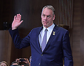 United States Representative Ryan Zinke (Republican of Montana) is sworn-in to testify before the US Senate Committee on Energy and Commerce as it holds a hearing considering confirmation of his appointment to be US Secretary of the Interior on Capitol Hill in Washington, DC on Tuesday, January 17, 2017.<br /> Credit: Ron Sachs / CNP