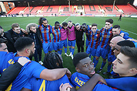 Maldon players huddle on the pitch after their win during Leyton Orient vs Maldon & Tiptree, Emirates FA Cup Football at The Breyer Group Stadium on 10th November 2019