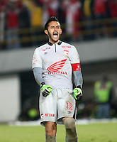 BOGOTA - COLOMBIA -21 -12-2014: Camilo Vargas,  portero de Independiente Santa Fe celebra el campeonato ganado al  Deportivo Independiente Medellin durante partido de vuelta entre Independiente Santa Fe y Deportivo Independiente Medellin por la final de la Liga Postobon II-2014, en el estadio Nemesio Camacho El Campin de la ciudad de Bogota. / Camilo Vargas, goalkeeper of Independiente Santa Fe, celebrates the championship won to Deportivo Independiente Medellin during a match of the second leg between Independiente Santa Fe and Deportivo Independiente Medellin for the finals of the Liga Postobon II -2014 at the Nemesio Camacho El Campin Stadium in Bogota city, Photo: VizzorImage / Nestor Silva / Cont.