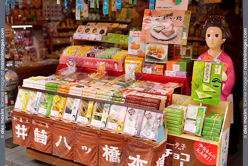 Miyagegashi souvenir sweets, on a store display in Kyoto. Flavoured sweet Yatsuhashi triangles with red bean paste, traditional Kyoto confectionery. Japan 2017
