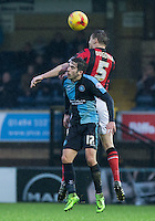 Max Kretzschmar of Wycombe Wanderers & Adam Dugdale of Morecambe go up for the ball during the Sky Bet League 2 match between Wycombe Wanderers and Morecambe at Adams Park, High Wycombe, England on 2 January 2016. Photo by Andy Rowland / PRiME Media Images