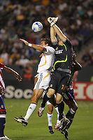 Chivas goalkeeper Brad Guzan (18) goes high to block a ball over LA Galaxy forward Alan Gordon (21). CD Chivas USA defeated the LA Galaxy 3-0 in the Super Classico MLS match at the Home Depot Center in Carson, California, Thursday, August 23, 2007.