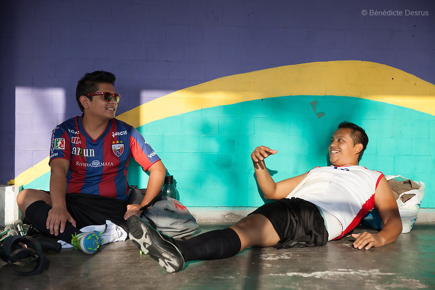 """(L-R) Isay Isidoro Larios Ibarra and Victor Hugo Bonilla Gonzalez, both players from Guerreros Aztecas, get changed before training in Mexico City, Mexico on June 12, 2014. Isay, 21, lost his left leg in a motorcycle accident. He is a student. Victor, 32, lost his left leg after an assault in 2011. He is currently unemployed and he wants to be a DJ. Guerreros Aztecas (""""Aztec Warriors"""") is Mexico City's first amputee football team. Founded in July 2013 by five volunteers, they now have 23 players, seven of them have made the national team's shortlist to represent Mexico at this year's Amputee Soccer World Cup in Sinaloathis December.The team trains twice a week for weekend games with other teams. No prostheses are used, so field players missing a lower extremity can only play using crutches. Those missing an upper extremity play as goalkeepers. The teams play six per side with unlimited substitutions. Each half lasts 25 minutes. The causes of the amputations range from accidents to medical interventions – none of which have stopped the Guerreros Aztecas from continuing to play. The players' age, backgrounds and professions cover the full sweep of Mexican society, and they are united by the will to keep their heads held high in a country where discrimination against the disabled remains widespread.(Photo byBénédicte Desrus)"""