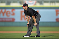 Umpire Tanner Moore handles the calls on the bases during the South Atlantic League game between the Kannapolis Intimidators and the Augusta GreenJackets at SRG Park on July 6, 2019 in North Augusta, South Carolina. The Intimidators defeated the GreenJackets 9-5. (Brian Westerholt/Four Seam Images)