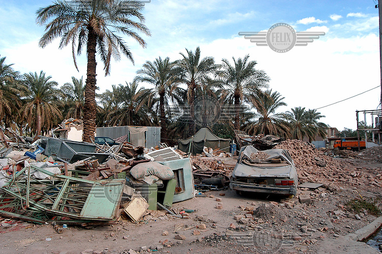 One year on from the Bam earthquake, many houses are still in ruins. An earthquake measuring 6.3 on the Richter scale caused widespread devastation in the ancient city of Bam and other parts of Kerman Province, leaving at least 30,000 people dead.