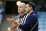 30 October 2013: Carson-Newman head coach Mike Mincey (rght) talks with referee Mark Behrens. The University of North Carolina Tar Heels played the Carson-Newman College Eagles in a women's college basketball exhibition game at Carmichael Arena in Chapel Hill, North Carolina. UNC won the preseason game 111-50.