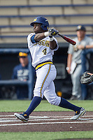 Michigan Wolverines second baseman Ako Thomas (4) follows through on his swing against the Toledo Rockets on April 20, 2016 at Ray Fisher Stadium in Ann Arbor, Michigan. Michigan defeated Bowling Green 2-1. (Andrew Woolley/Four Seam Images)