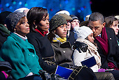 United States President Barack Obama, accompanied by Marian Robinson, Michelle Obama's mother, left to right, First Lady Michelle Obama, and their daughters Malia and Sasha, watch during the National Christmas Tree lighting ceremony on the Ellipse near the White House in Washington, DC, on Thursday, December 9, 2010. The first Christmas tree lighting ceremony took place back in 1923, with U.S. President Calvin Coolidge presiding..Credit: Andrew Harrer / Pool via CNP