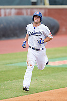 Scott Schebler (8) of the Chattanooga Lookouts jogs towards home plate after hitting a home run against the Montgomery Biscuits at AT&T Field on July 23, 2014 in Chattanooga, Tennessee.  The Lookouts defeated the Biscuits 6-5. (Brian Westerholt/Four Seam Images)