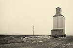 An old grain silo with a sign in a remote part of Eastern Washington State.