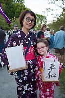 Mother & Daughter Holding Lanterns, From Hiroshima to Hope 2015, Seattle, WA, USA.