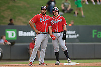 Catcher Shea Langeliers (4) of the Rome Braves, right, talks with manager Matt Tuiasosopo on third base in a game against the Greenville Drive on Thursday, June 27, 2019, at Fluor Field at the West End in Greenville, South Carolina. Rome won, 4-3. (Tom Priddy/Four Seam Images)