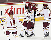 Emily Pfalzer (BC - 14), Melissa Bizzari (BC - 4), Kristyn Capizzano (BC - 7), Emily Field (BC - 15) - The Boston College Eagles defeated the Northeastern University Huskies 3-0 on Tuesday, February 11, 2014, to win the 2014 Beanpot championship at Kelley Rink in Conte Forum in Chestnut Hill, Massachusetts.