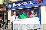 ROAD TO A MILLION: Joseph Wall, Cloghers who came second in Boyle Sports Road to a Million competition receiving his 10,000 euros cheque at Boyle Sports, Edward Street, Tralee on Friday l-r: Michael Slattery (manager), Joseph Wall and Gordon Downey (area manager).