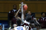 22 March 2015: Mississippi State's Martha Alwal (10) blocks a shot by Duke's Elizabeth Williams (behind). The Duke University Blue Devils hosted the Mississippi State University Bulldogs at Cameron Indoor Stadium in Durham, North Carolina in a 2014-15 NCAA Division I Women's Basketball Tournament second round game. Duke won the game 64-56.