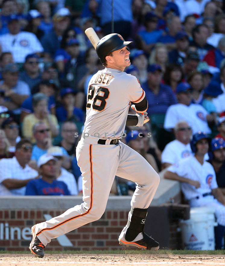 San Francisco Giants  Buster Posey (28) during a game against the Chicago Cubs on September 3, 2016 at Wrigley Field in Chicago, IL. The Giants beat the Cubs 3-2.