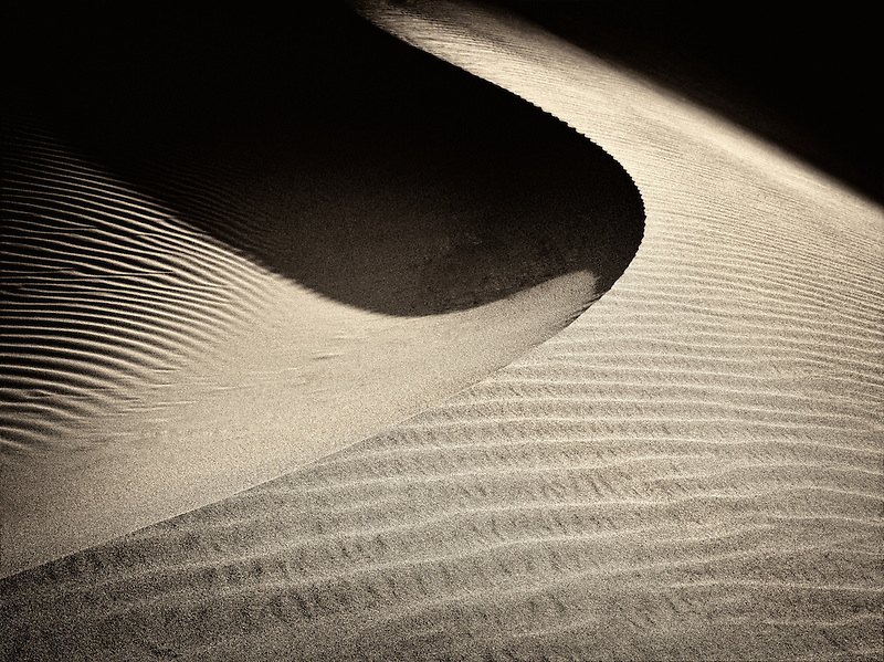 Minutes after sunup on sand dunes. Death Valley National Park, California