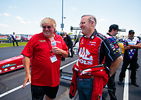 Jun 8, 2019; Topeka, KS, USA; NHRA top fuel driver Doug Kalitta (right) with Tommy Thompson during qualifying for the Heartland Nationals at Heartland Motorsports Park. Mandatory Credit: Mark J. Rebilas-USA TODAY Sports
