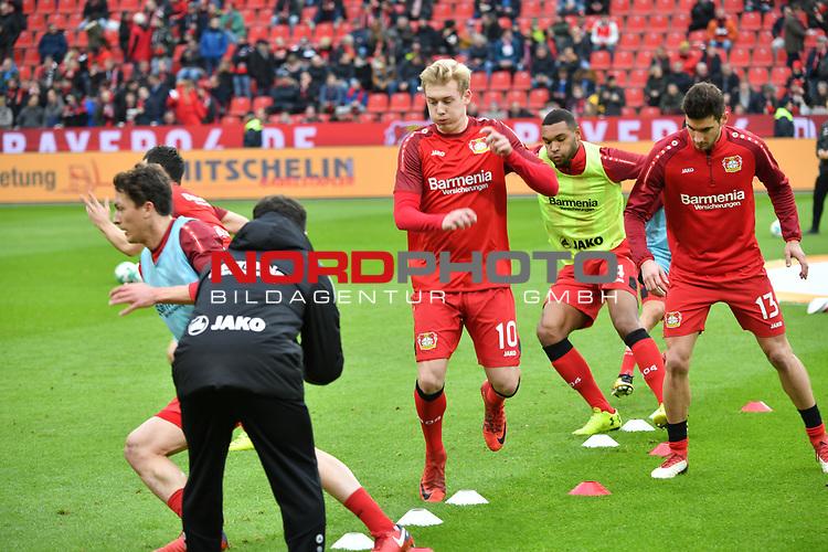 28.01.2018, BayArena, Leverkusen , GER, 1.FBL., Bayer 04 Leverkusen vs. 1. FSV Mainz 05<br /> im Bild / picture shows: <br /> Julian Brandt (Leverkusen #10), Lucas Alario (Leverkusen #13),  Jonathan Tah (Leverkusen #4), beim Aufwaermen, Einzelaktion,  <br /> <br /> <br /> Foto &copy; nordphoto / Meuter