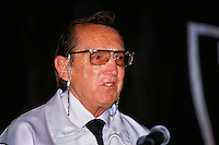 OAKLAND, CA - Owner Al Davis of the Oakland Raiders meets the press at a press conference announcing the return of the Raiders from Los Angeles to Oakland at the Oakland Coliseum in Oakland, California in 1995. Photo by Brad Mangin