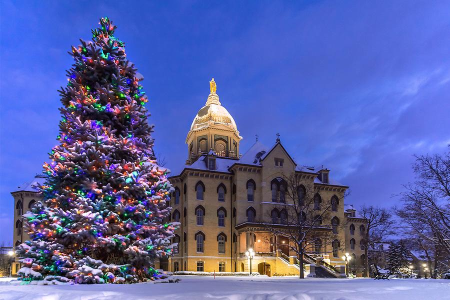 December 25, 2017; Christmas tree and Main Building (Photo by Matt Cashore/University of Notre Dame)