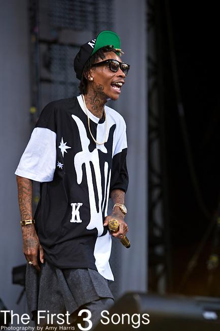 Wiz Khalifa (born Cameron Jibril Thomaz) performs during the 2013 Budweiser Made in America Festival in Philadelphia, Pennsylvania.