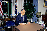 ***FILE PHOTO*** George H.W. Bush Has Passed Away<br /> United States President George H.W. Bush poses for photos in the Oval Office of the White House in Washington, D.C. after announcing the start of the air offensive to liberate Kuwait after it was overrun by Iraq on January 16, 1991.<br /> CAP/MPI/RS<br /> &copy;RS/MPI/Capital Pictures