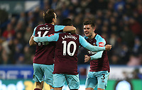 West Ham United's Manuel Lanzini celebrates scoring his side's third goal with Mark Noble and Aaron Cresswell<br /> <br /> Photographer Rob Newell/CameraSport<br /> <br /> The Premier League - Huddersfield Town v West Ham United - Saturday 13th January 2018 - John Smith's Stadium - Huddersfield<br /> <br /> World Copyright &copy; 2018 CameraSport. All rights reserved. 43 Linden Ave. Countesthorpe. Leicester. England. LE8 5PG - Tel: +44 (0) 116 277 4147 - admin@camerasport.com - www.camerasport.com