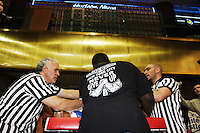 "Arm wrestlers compete at the Empire State Finals at the Port Authority Bus Terminal in New York City on November 17, 2005.  The Empire State Finals is the culmination in the year of the New York City Arm Wrestling Association's ""Golden Arm Series""."