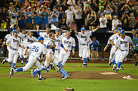 The UCLA Bruins celebrate the final out of the 2013 Men's College World Series over the Mississippi State Bulldogs on June 25, 2013 at TD Ameritrade Park in Omaha, Nebraska. The Bruins defeated the Bulldogs 8-0, winning the National Championship. (Andrew Woolley/Four Seam Images)