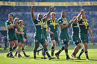 Vereniki Goneva raises his arms in triumph as the Leicester Tigers team tour the pitch in celebration. Aviva Premiership Final, between Leicester Tigers and Northampton Saints on May 25, 2013 at Twickenham Stadium in London, England. Photo by: Patrick Khachfe / Onside Images