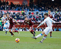 Dries Mertens shoots and scores a penalty  during the  italian serie a soccer match,between SSC Napoli and Torino       at  the San  Paolo   stadium in Naples  Italy , December 18, 2016