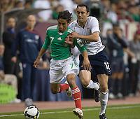 Ramiro Corrales, right, and Mexico's Fernando Arce battle for the ball during a 2-2 tie,.USA vs Mexico, Wednesday, Feb. 6, 2008, Reliant Stadium, Houston, Texas.