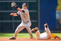 Michael Ratterree #8 of the Rice Owls reaches for a throw as Joey Hainsfurther #1 of the Baylor Bears slides head first into second base at Minute Maid Park on March 6, 2011 in Houston, Texas.  Photo by Brian Westerholt / Four Seam Images