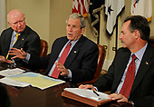 Washington, DC - September 14, 2008 -- United States President George W. Bush (C) briefs the press on relief efforts in the aftermath of Hurricane Ike after a meeting with administration officials, 14 September 2008 at the White House.  Federal Emergency Management Agency Administrator David Paulison (R) and Energy Secretary Samuel Bodman listen to his remarks.    <br /> Credit: Mike Theiler / Pool via CNP