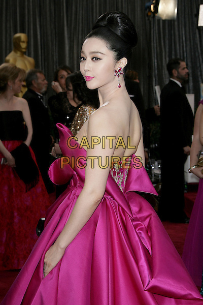 Fan Bingbing.85th Annual Academy Awards held at the Dolby Theatre at Hollywood & Highland Center, Hollywood, California, USA..February 24th, 2013.oscars half length pink silk satin strapless dress gown folds side.CAP/ADM.©AdMedia/Capital Pictures.