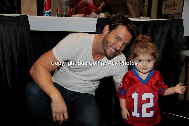 """Days of Our Lives Eric Martsolf """"Brady Black"""" poses with fan wearing Tom """"Brady"""" shirt as he appears at the 12th Annual Comcast Women's Expo on September 7 (also 2014 at the Connecticut Convention Center, Hartford, CT. He signed photos, posed with fans.  (Photo by Sue Coflin/Max Photos)"""