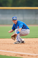 GCL Blue Jays third baseman Davis Schneider (76) fields a ground ball during the second game of a doubleheader against the GCL Yankees East on July 24, 2017 at the Yankees Minor League Complex in Tampa, Florida.  GCL Yankees East defeated the GCL Blue Jays 6-3.  (Mike Janes/Four Seam Images)