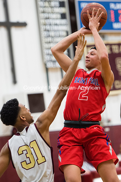 WATERBURY, CT- 24 February 2016-022416EC05-   St. Paul's Austin Jones goes up for two in front of Sacred Heart defender JT Riddick Wednesday night in Waterbury. Erin Covey Republican-American