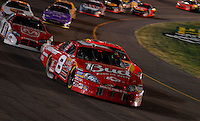 Apr 22, 2006; Phoenix, AZ, USA; Nascar Nextel Cup driver Dale Earnhardt Jr. of the (8) Budweiser Chevrolet Monte Carlo leads a pack of cars during the Subway Fresh 500 at Phoenix International Raceway. Mandatory Credit: Mark J. Rebilas-US PRESSWIRE Copyright © 2006 Mark J. Rebilas