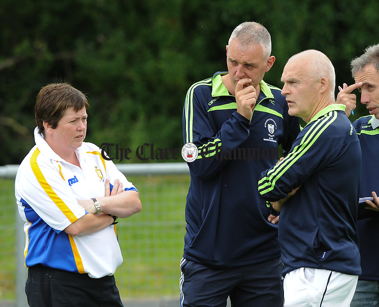 Clare manager Colm Honan  with selectors Patricia O Grady and Peter Casey on the sideline at half time during their Senior Championship game against Tipperary at Sixmilebridge. Photograph by John Kelly.