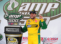 Oct 5, 2008; Talladega, AL, USA; NASCAR Sprint Cup Series driver Tony Stewart in victory lane after winning the Amp Energy 500 at the Talladega Superspeedway. Mandatory Credit: Mark J. Rebilas-