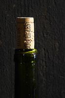 cork and bottle on a vat domaine du vissoux beaujolais burgundy france